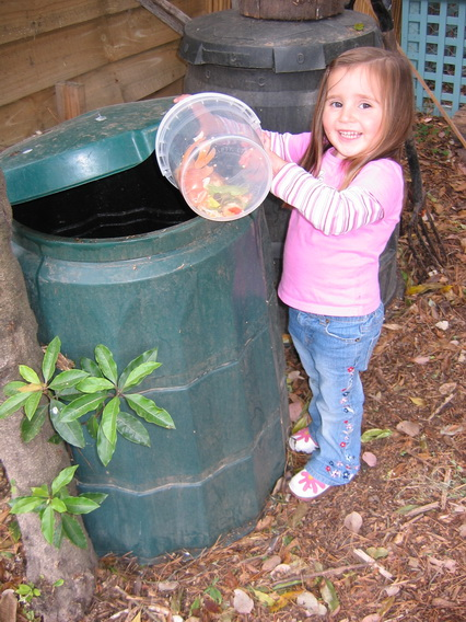 adding kitchen scraps to compost